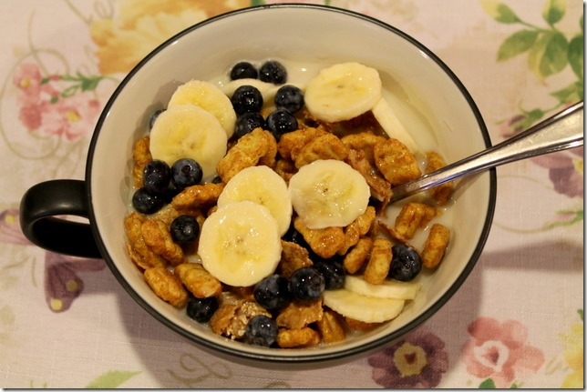 Cereal with almond milk, bananas, and blueberries