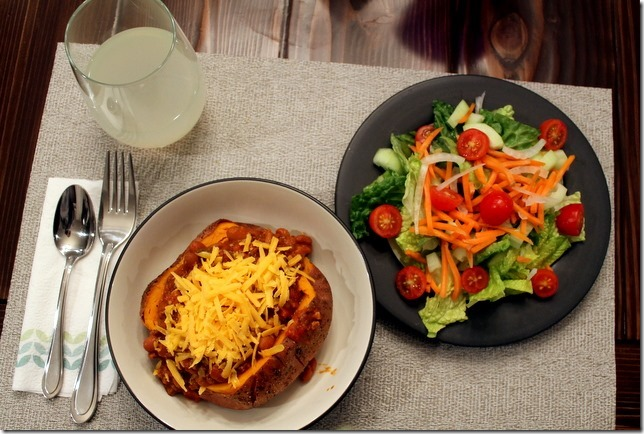 Chili stuffed sweet potatoes with side salads